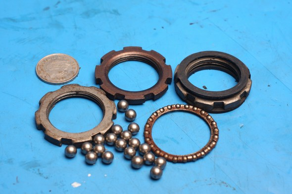 Steering head bearings top and bottom used Peugeot Elystar125